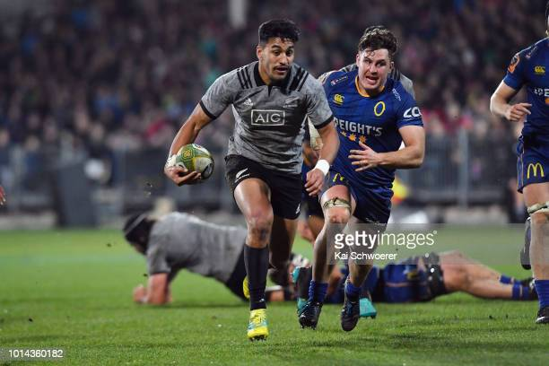 Rieko Ioane of the All Blacks runs through to score a try during the Game of Three Halves between the New Zealand All Blacks and Otago at AMI Stadium...