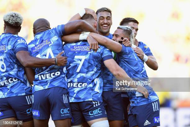 Rieko Ioane of the Blues and his team mates celebrate after Dalton Papalii of the Blues scored a try during the round one Super Rugby Aotearoa match...