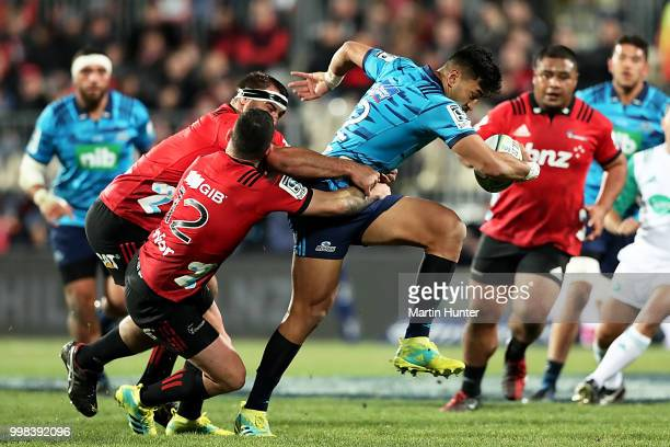 Rieko Ioane of the Blues breaks through a tackle during the round 19 Super Rugby match between the Crusaders and the Blues at AMI Stadium on July 14...