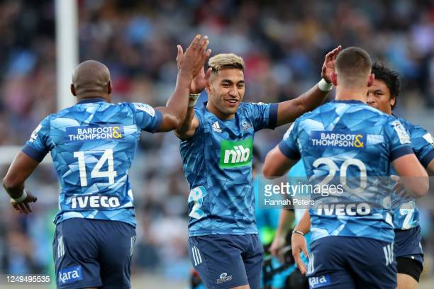 Rieko Ioane of the Blues celebrates after Dalton Papalii of the Blues scored a try during the round 1 Super Rugby Aotearoa match between the Blues...