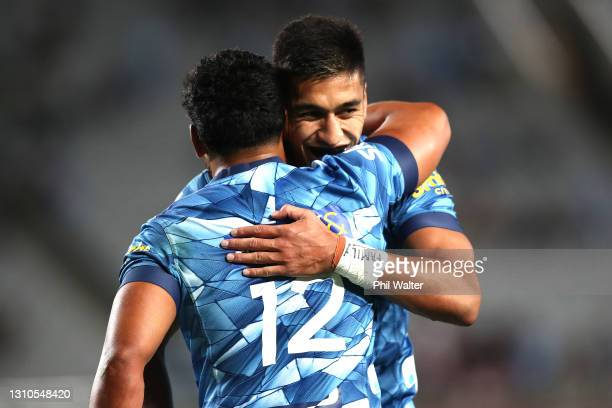 Rieko Ioane of the Blues congratulats Tj Faiane of the Blues on his try during the round 6 Super Rugby Aotearoa match between the Blues and the...