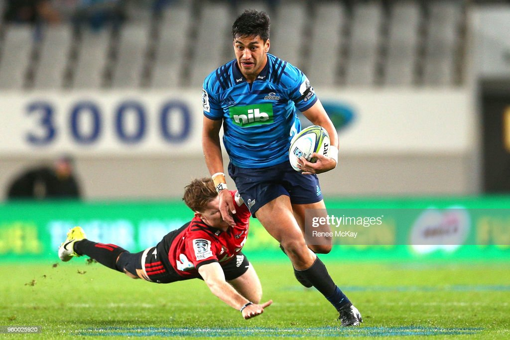 Rieko Ioane of the Blues gets away from Jack Goodhue of Crusaders during the round 14 Super Rugby match between the Blues and the Crusaders at Eden Park on May 19, 2018 in Auckland, New Zealand.