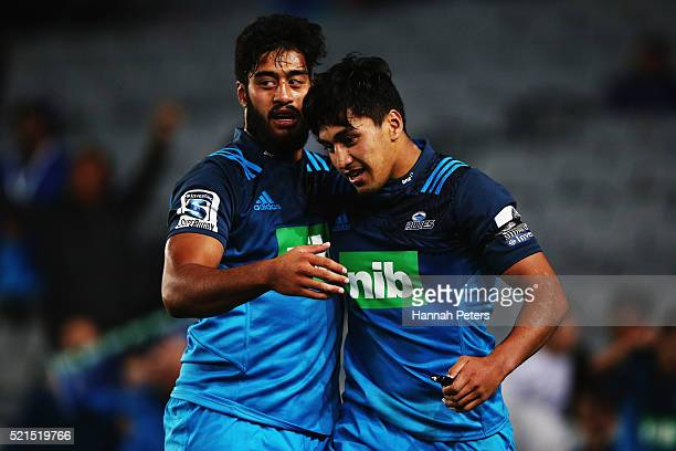 Rieko Ioane of the Blues is congratulated by Akira Ioane of the Blues after scoring a try during the round eight Super Rugby match between the Blues...