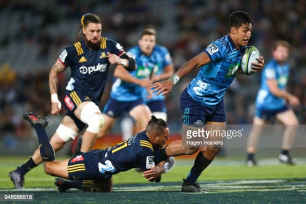 Rieko Ioane of the Blues is tackled by Aaron Smith of the Highlanders during the round 10 Super Rugby match between the Blues and the Highlanders at...