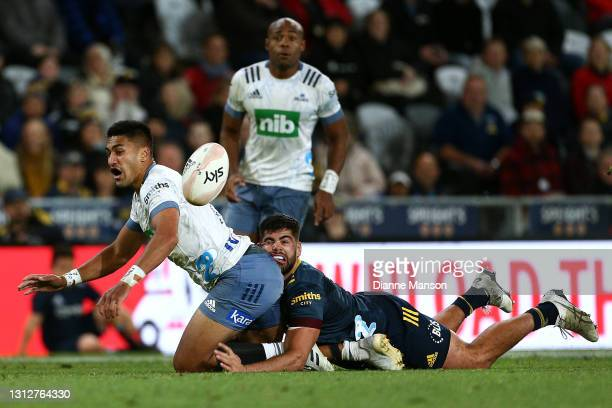 Rieko Ioane of the Blues is tackled by Billy Harmon of the Highlanders during the round eight Super Rugby Aotearoa match between the Highlanders and...
