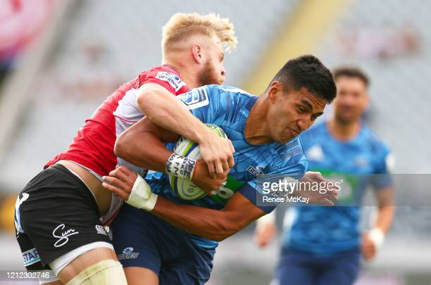 Rieko Ioane of the Blues is tackled by Tyrone Green of the Lions during the round seven Super Rugby match between the Blues and the Lions at Eden...