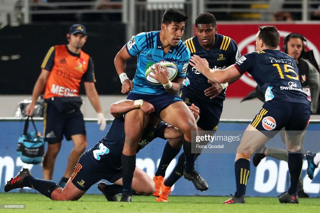 Rieko Ioane of the Blues is tackled (C) during the round 10 Super Rugby match between the Blues and the Highlanders at Eden Park on April 20, 2018 in Auckland, New Zealand.