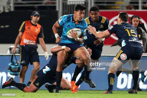 Rieko Ioane of the Blues is tackled during the round 10 Super Rugby match between the Blues and the Highlanders at Eden Park on April 20 2018 in...