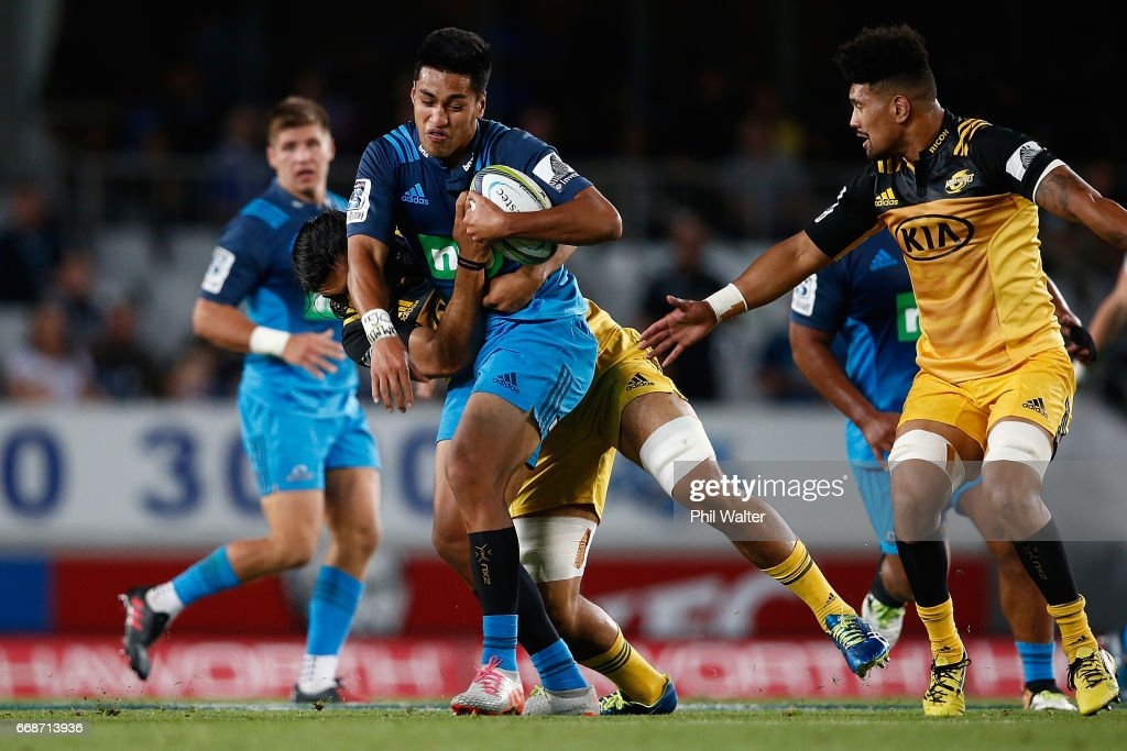 Rieko Ioane of the Blues is tackled during the round eight Super Rugby match between the Blues and the Hurricanes at Eden Park on April 15, 2017 in Auckland, New Zealand.