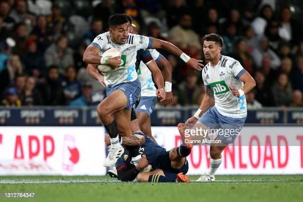 Rieko Ioane of the Blues makes a break during the round eight Super Rugby Aotearoa match between the Highlanders and the Blues at Forsyth Barr...