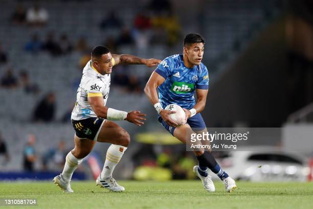 Rieko Ioane of the Blues makes a run against Ngani Laumape of the Hurricanes during the round 6 Super Rugby Aotearoa match between the Blues and the...