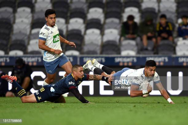 Rieko Ioane of the Blues scores a try during the round eight Super Rugby Aotearoa match between the Highlanders and the Blues at Forsyth Barr...