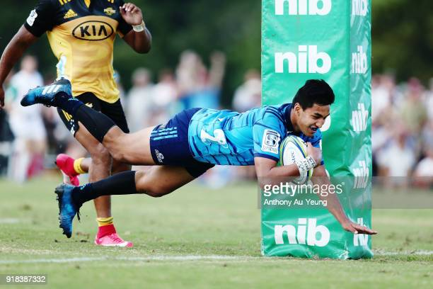 Rieko Ioane of the Blues scores a try during the Super Rugby trial match between the Blues and the Hurricanes at Mahurangi Rugby Club on February 15...