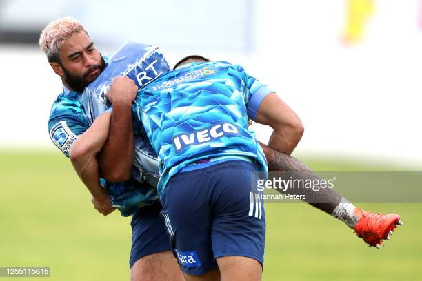 Rieko Ioane of the Blues tackles Akira Ioane of the Blues during a Blues Super Rugby training session at Blues HQ on July 09, 2020 in Auckland, New...