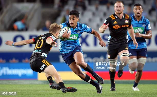 Rieko Ioane of the Blues takes on the tackle of Damian McKenzie of the Chiefs during the round two Super Rugby match between the Blues and the Chiefs...