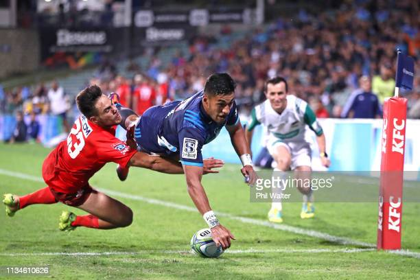 Rieko Ioane of the Blues touches down to score his third try despite the efforts of Phil Burleigh of the Sunwolves during the round four Super Rugby...