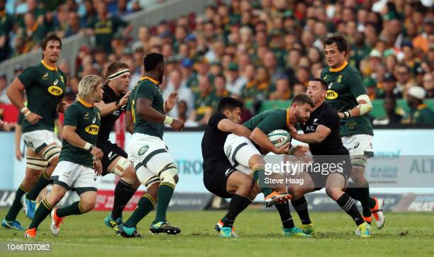 Rieko Ioane of the New Zealand tackling Willie le Roux of South Africa during the Rugby Championship match between South Africa Springboks and New...
