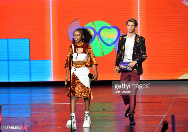 Riele Downs and Jace Norman enter onstage at Nickelodeon's 2019 Kids' Choice Awards at Galen Center on March 23 2019 in Los Angeles California