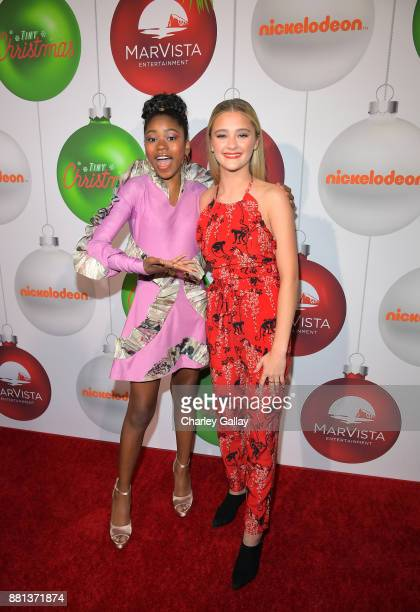 Riele Downs and Lizzy Greene at the premiere of The Nickelodeon Movie Tiny Christmas on November 28 2017 in Hollywood California