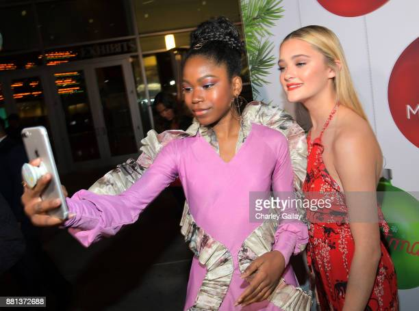 Riele Downs and Lizzy Greene at the premiere of The Nickelodeon Movie 'Tiny Christmas' on November 28 2017 in Hollywood California