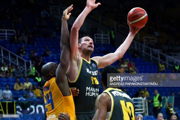 Riesen Ludwigsburg's Adam Waleskowski vies for the ball with UCAM Murcia's Kevin Tumba during the final four Champions League basketball 3rd place...