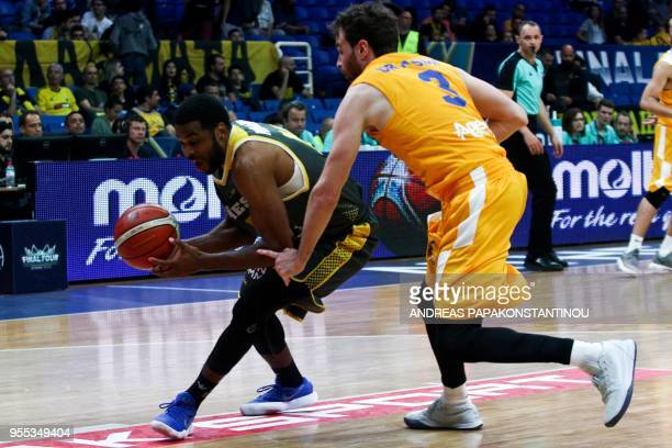 Riesen Ludwigsburg's Adika Peter McNeilly vies for the ball with UCAM Murcia's Alex Urtasun during the final four Champions League basketball 3rd...