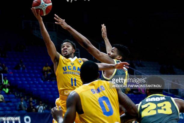 Riesen Ludwigsburg's Adika Peter McNeilly vies with UCAM Murcia's Clevin Hannah during the final four Champions League basketball 3rd place game...