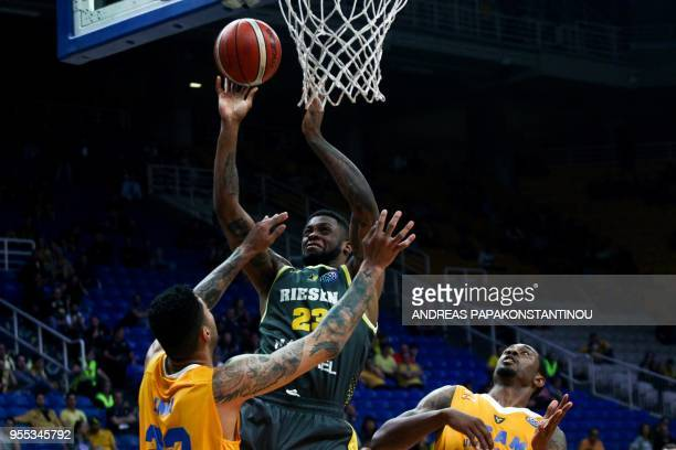 Riesen Ludwigsburg's Elgin Cook vies for the ball with UCAM Murcia's Augusto Lima during the final four Champions League basketball 3rd place game...