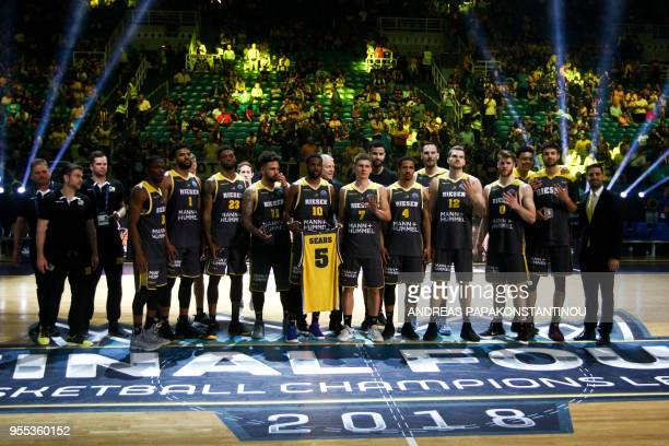 Riesen Ludwigsburg's players pose for a family photo after being placed fourth during the Final Four Champions League basketball game between Riesen...