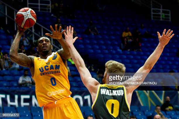 Riesen Ludwigsburg's Thomas Walkup vies with UCAM Murcia's Ovle Soko during the final four Champions League basketball 3rd place game between Riesen...