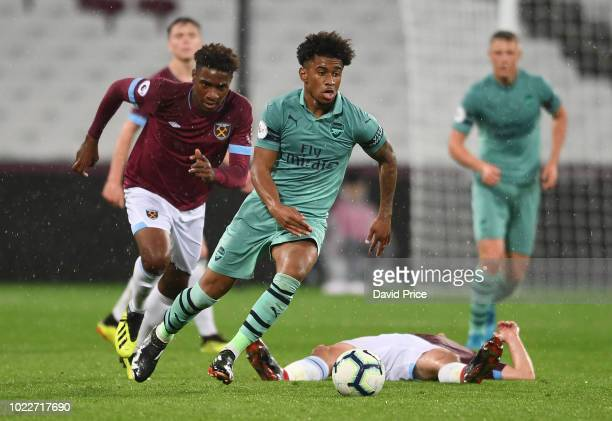 Riess Nelson of Arsenal challenges Jahmal HectorIngram of West Ham for the ball during the match between West Ham United U23 and Arsenal U23 at...