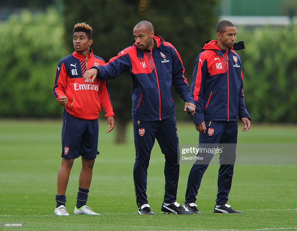 Riess Nelson of Arsenal with Thierry Henry and Ryan Garry Arsenal Coach during the U19 training session at London Colney on September 15, 2015 in St Albans, England.