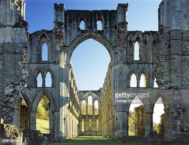 Rievaulx Abbey, North Yorkshire, c1990-2010. The crossing and east end of the abbey church showing autumn colour on the trees beyond. A former...
