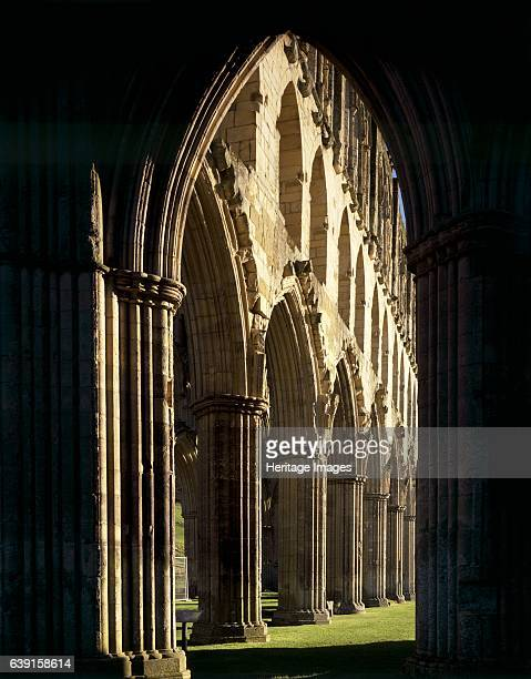 Rievaulx Abbey North Yorkshire c19902010 View through silhouetted arch to Presbytery arcade looking North East A former Cistercian abbey in the North...