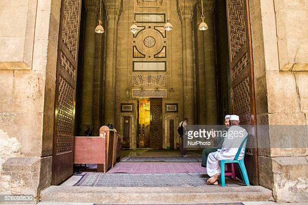Rifai mosque entrance which is located in front of the mosque of Sultan Hassan directly And a factor mosque sitting and talking in front of the door...