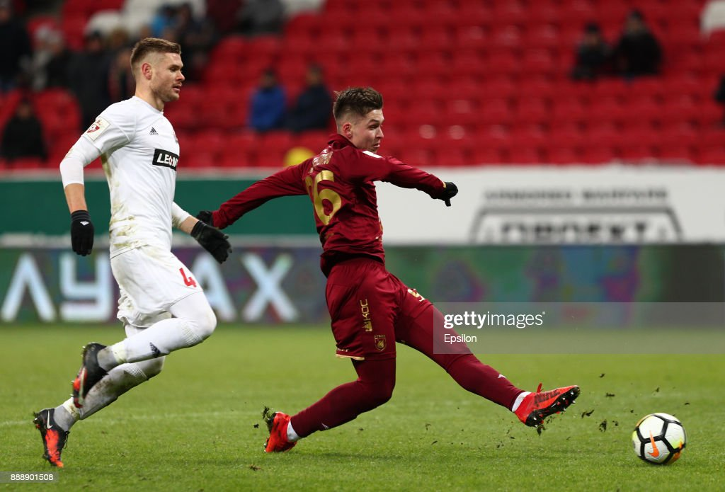 Rifat Zhemaletdinov (r) of FC Rubin Kazan vies for the ball with Maksim Tishkin SKA Khabarovsk during the Russian Premier League match between FC Rubin Kazan and SKA Khabarovsk at Kazan Arena stadium on December 9, 2017 in Kazan, Russia.