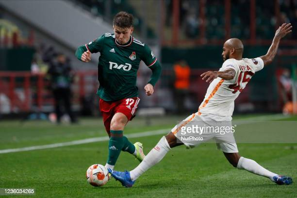 Rifat Zhemaletdinov of Lokomotiv Moscow and Marcao of Galatasaray vie for the ball during the UEFA Europa League Group E football match between FC...