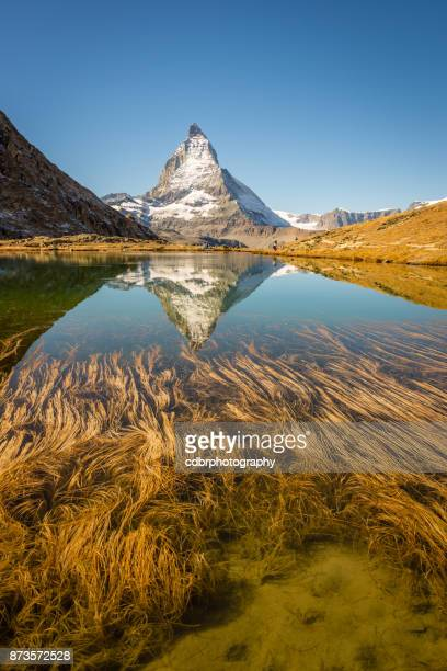riffelsee and matterhorn reflection - zermatt stock pictures, royalty-free photos & images