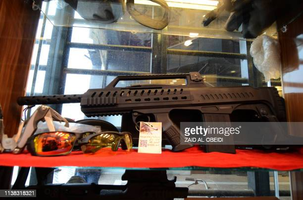 A rifle and other items are diplayed in a gun shop in the northern Iraqi city of Mosul on January 28 2019 Hunting rifles pistols and towers of...