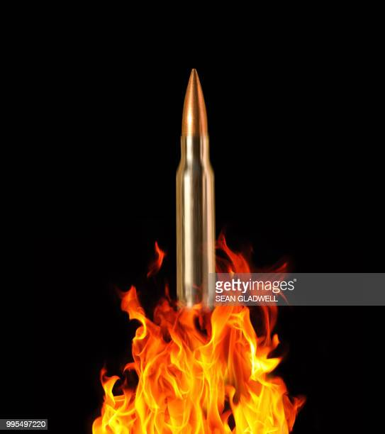 rifle bullet and fire - ammunition stock pictures, royalty-free photos & images