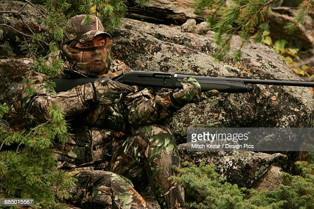 rifle hunter hunting big game - turkey hunting stock photos and pictures