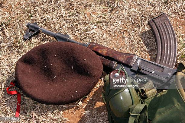 A rifle, military cover and canteen of a Mozambican soldier.