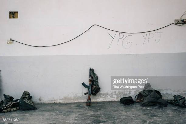 A rifle rests against a wall at a rear base used by YPG and YPJ fighters near Tal Samin Syria