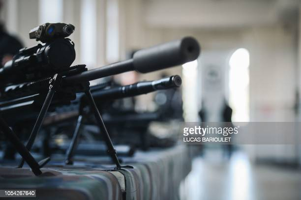 A rifle used by the French Research Assistance Intervention Deterrence Police Unit is seen during a visit of French Interior Minister at the RAID...