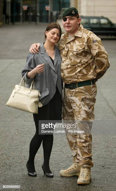 Rifleman Paul Jacobs of The Rifles who was awarded a George Medal in the Operational Awards List and his fiancee Louise Smith at a ceremony at the...