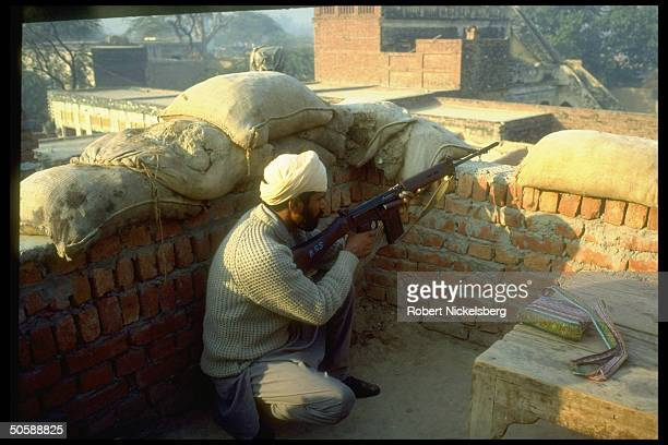 Riflepoised antimilitant Sikh manning his post member of local militia armed by authorities battling militants