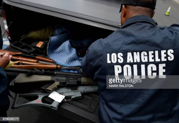 Rifles and assault rifles among a batch of thirteen that were exchanged for gift cards are seen during a Los Angeles Police Department and Mayor's...