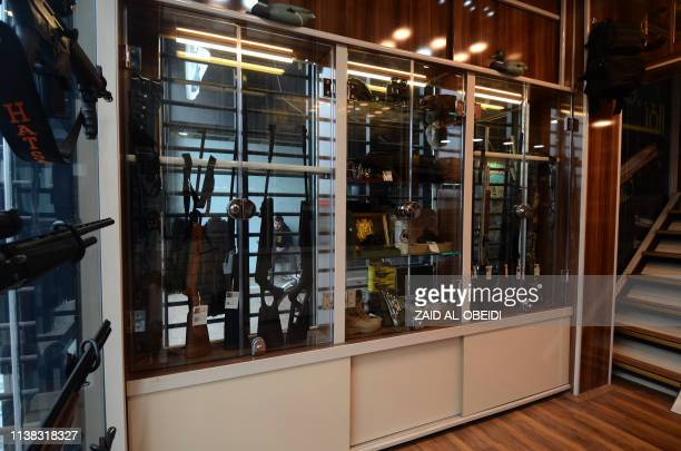 Rifles and other items are diplayed in a gun shop in the northern Iraqi city of Mosul on January 28 2019 Hunting rifles pistols and towers of...