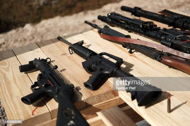 "Rifles and other weapons are displayed on a table at a shooting range during the ""Rod of Iron Freedom Festival"" on October 12, 2019 in Greeley,..."