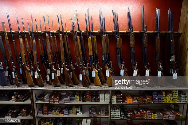 Rifles are displayed at FiringLine July 22 2012 in Aurora Colorado FiringLine is located not far from where suspect gunman James Eagan Holmes is...